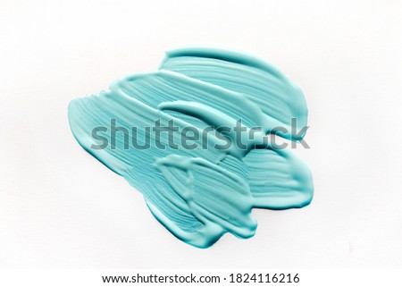 Photo of  Aqua color opaint on white background. Aqua colour of the year 2021