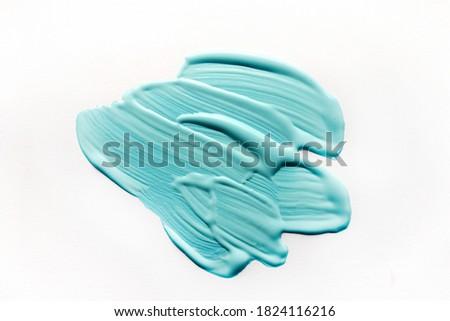 Photo of  Aqua color opaint on white background. Aqua colour of the year 2021