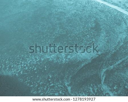 Aqua colored beach #1278193927