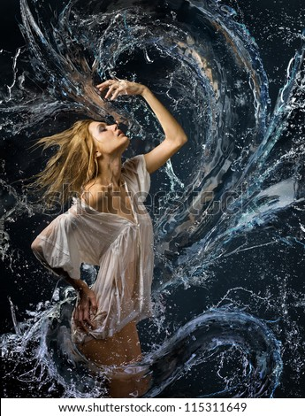 Aqua girl with wet shirt in a spray of water a liquid dragon before her #115311649
