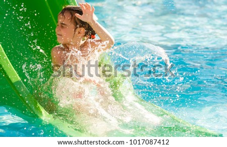 aqua park, Girl slide down on water slide