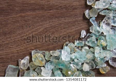 Aquamarine gemstone on wood background. Aquamarine crystal.  #1354081172