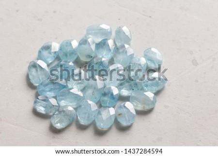 Aquamarine stone. Natural stone and aquamarine crystals on a white background. Beautiful aquamarine stones. #1437284594