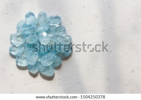 Aquamarine stone. Natural stone and aquamarine crystals on a white background. Beautiful aquamarine stones. Copy space for your text. #1504250378