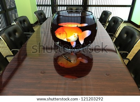 Aquarium with fish on an office desk.