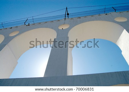 Aqueduct arches against blue sky