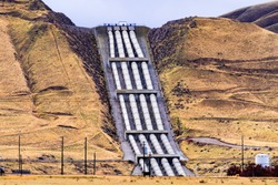 Aqueducts at the south end of San Joaquin Valley, taking pumped water uphill, over the Grapevine, en route to Los Angeles, part of the California State Water Project, California, USA
