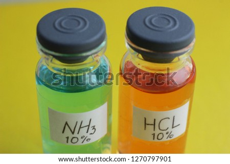 Aqueous solutions of ammonia and hydrochloric acid, the concentration of substances 10 percent. The solutions are colored indicator dye.
