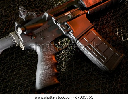 ar-15 that is on a dark background with red lighting
