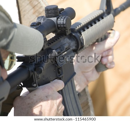 AR-15 with smoke coming from its chamber as another round is chambered