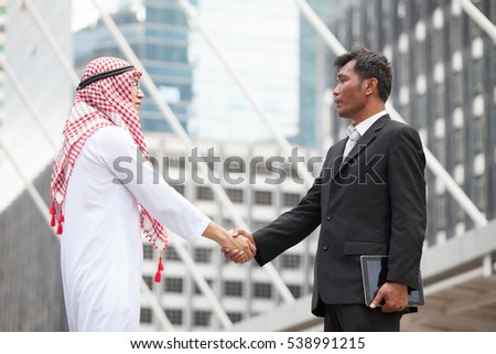 Arab Businessmen's Handshake partnered with American Businessman descent. Confirmation of a business alliance partners as well. Adhering Respect, Commitment and integrity in business.