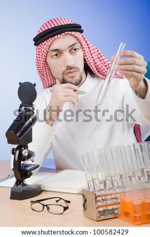 Arab chemist working in lab