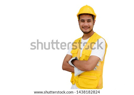 Arab Construction beard worker with yellow safety helmet isolated on white background with copy space for text. Portrait of happy foreman man smiling. Heavy industry and business concept.