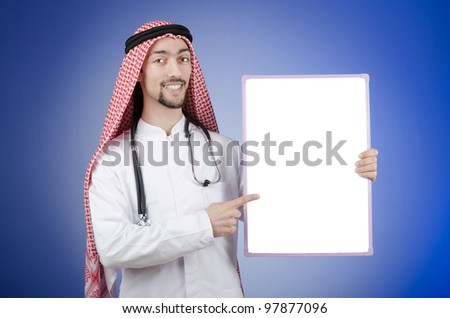 Arab doctor with blank message board - stock photo