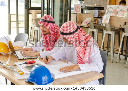 Arab engineers are working diligently. They have expertise in construction. #1438438616