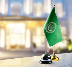 Arab League flag on the reception desk in the lobby of the hotel