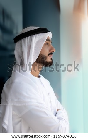 Arab Man looking out side