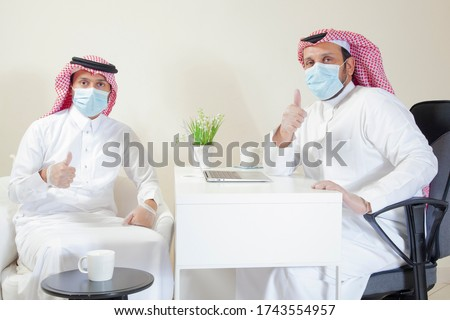 Arab man Office Resume after Corona Virus Pandemic with Protection Mask