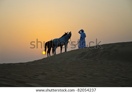 Arab Man with Arabian Horse in the Arabian Desert during the sunset