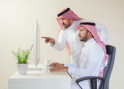 Arab man working and discussing work