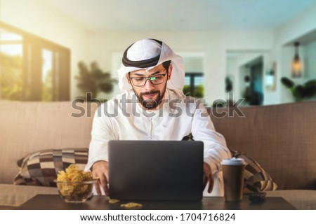 Arab man working from home sitting on sofa. coronavirus Quarantine.