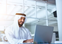 Arab Man working on Laptop