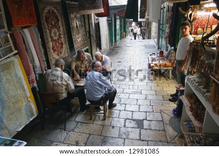 Arab men playing backgammon, old city, jerusalem, israel.