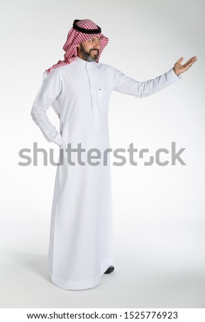 Arab middle eastern Saudi man in traditional formal thobe and Shimagh, on white isolated background, with different expressions, hand gestures and poses, studio lighting ready for cutout and editing.