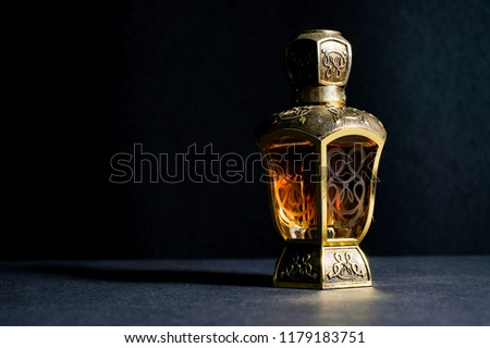 Arab perfume in exclusive bottle. Yellow colour liquid perfume specially made in classic and exotic bottle.