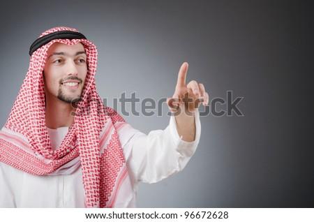 Arab pushing virtual buttons
