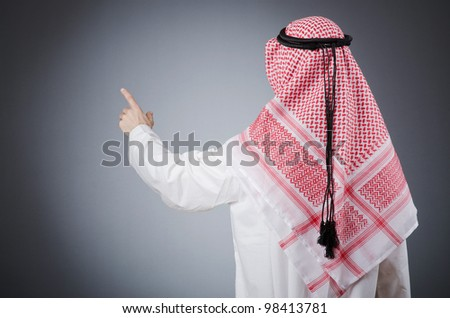 Arab pushing virtual buttons