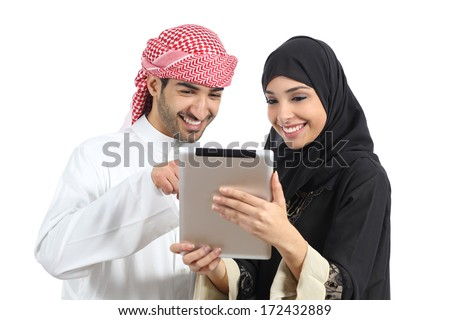 Arab saudi happy couple browsing a tablet reader isolated on a white background