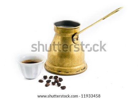 Arab small copper coffee pot with cup and coffee beans isolated on white