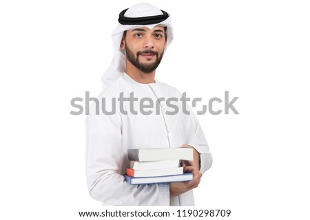 Arab student holding books standing on white background