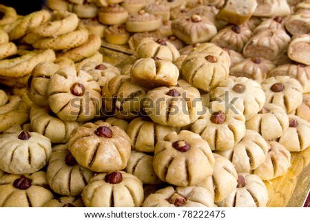 arab sweet pastries cakes stacked bakery with nuts