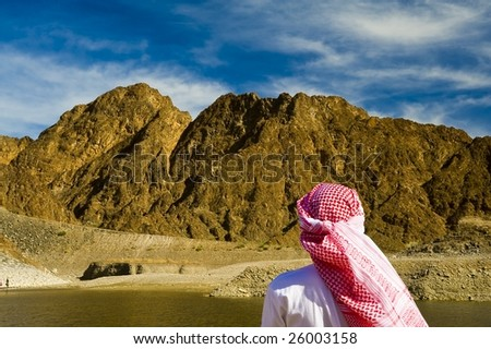 arab watching the mountains of the emirates