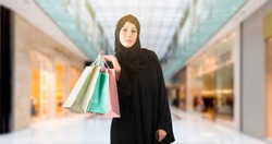 Arab Woman holding shopping bags