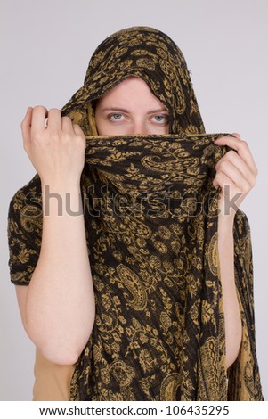 Arab woman with a scarf or veil covers his face