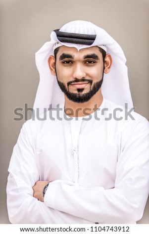 Arabian businessman portrait on grey background