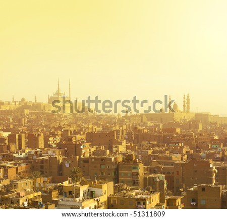 Arabian city in yellow gamma. Cairo - stock photo
