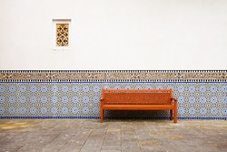 Arabian exterior with bench, wall with and window