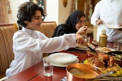 Arabian family having dinner, Arabian family eating iftar in Ramadan
