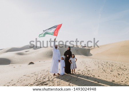 Arabian family spending a weekend in the desert, in Dubai