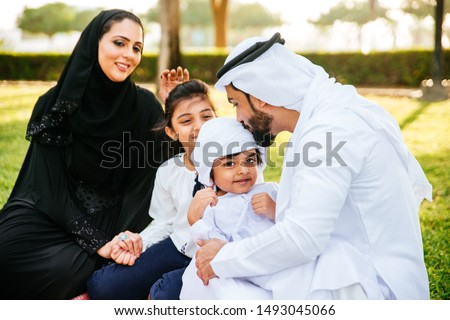 Arabian family spending time in a park