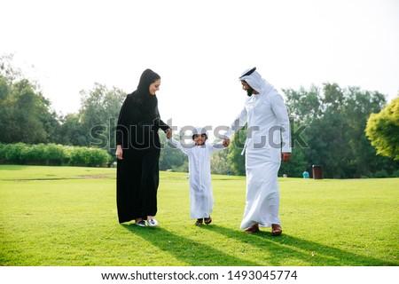 Arabian family spending time in a park