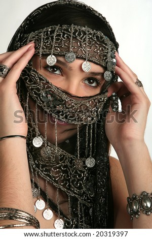 Arabian/indian woman with her face covered