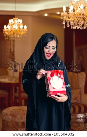 arabian lady wearing hijab happy for receiving a gift
