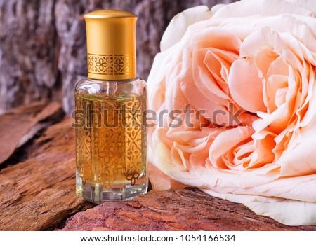 Arabian oud attar perfume or agarwood oil fragrances in mini bottle. #1054166534