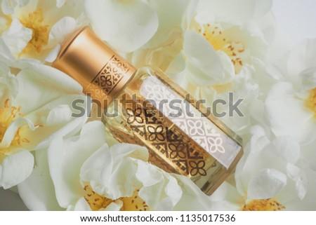 Arabian oud attar perfume or agarwood oil fragrances in mini bottle. #1135017536