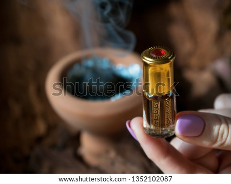 Arabian oud attar perfume or agarwood oil fragrances in mini bottle. #1352102087